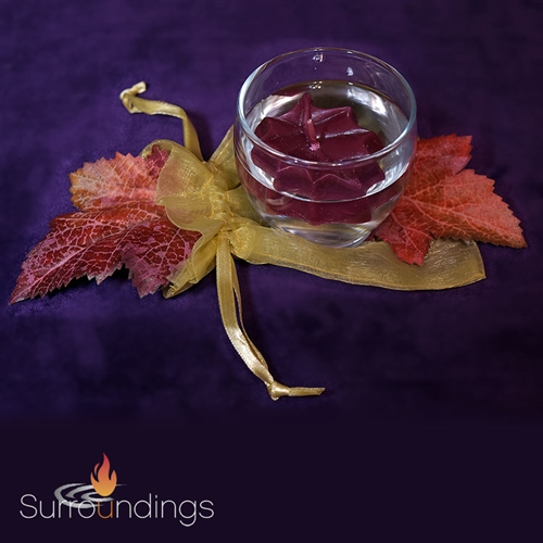 Mini Fall floating candle centerpiece with roly poly votive cup