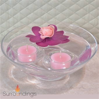 Glass tea light holder for floating tea lights