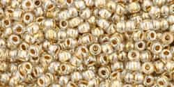 11/0 Toho 11TO989 Round Gold-Lined Crystal - 10 Grams