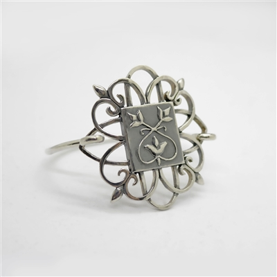 Tulip Bracelet photo. All silver, the center piece of this bracelet is the exact same design as the pedant in the Native Naiveté necklace. Swirls and tulip designs. Beautiful!