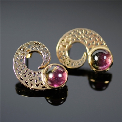 A Snail's Shell Earrings photo. These earrings are very special and unique. It is made from red gold, giving it an earthy complexion, and the watermelon tourmaline adds to that aspect as well. The design is just like its name with little perforations.