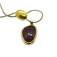 Handmade 18k gold and silver necklace with pink sapphire.