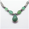 Vibrant Mint Necklace photo. Like the Lemongrass Drop necklace, its structure is silver, however this one is shorter. With a drop-like center chalcedony and other round chalcedonies on the sides. Detailed silver hoops come after the stones on the sides.