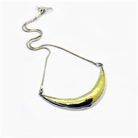 18k gold, fine and sterling silver hammered to shape.