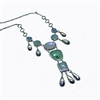 silver necklace with colored gems