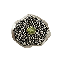 Handmade Ring made of sterling silver and 18k gold with peridot.