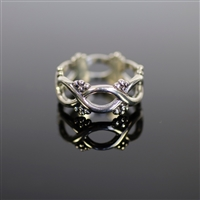 Elizabethan Ring photo. Polished- all silver band ring composed of all infinity- shape designs and little dots like flowers. Delicate and dainty.