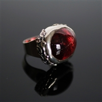 Bittersweet Affair Ring photo. Gorgeous and big red Rubelite is the center of the ring and a silver ring structure holds it with beautiful flowery designs on the sides.