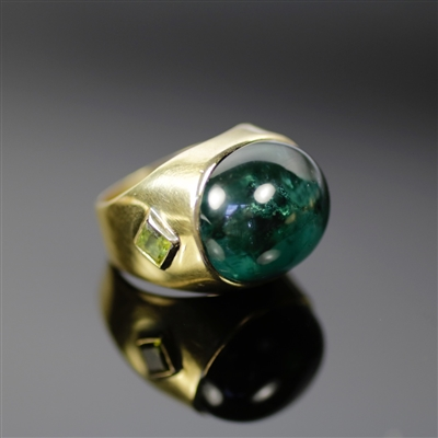 Dark Forest Ring photo. Gorgeous mix of 18k yellow gold and a darker green tourmaline, makes this piece very sophisticated. The center and top of the ring contains a round green tourmaline and one of the sides of has a detailed squared tourmaline as well.