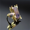 Dragonfly Ring photo. 18k yellow gold structures in the design of a delicate dragonfly, its body contains diamonds on the sides of the ring, and on top is a gorgeous purplish fluorite. So  gentle and graceful!
