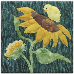 a fabric panel with a yellow chick standing on a large sun flower on a green background.