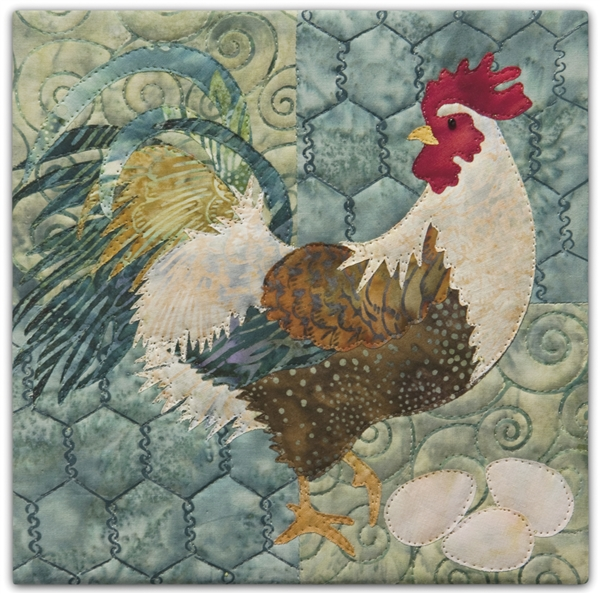 a fabric panel with a pretty brown speckled rooster looking over his shoulder while he guards three eggs