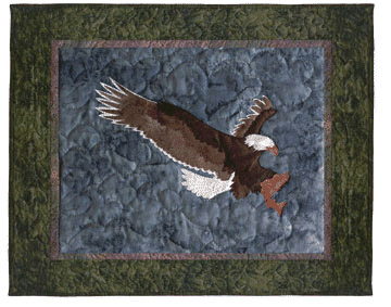 Quilt block of an eagle catching a trout