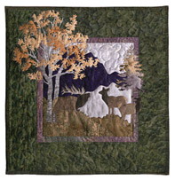 Quilt block showing elk, mountains, and trees