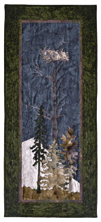 Quilt block of an eagle's nest atop a tree.