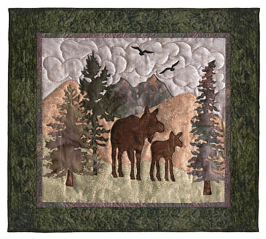 Quilt block of a mama and baby moose in the mountains.