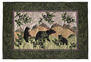 Quilt block of black bear cubs playing near a huckleberry bush, in the mountains.