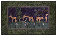 Quilt block of fawns playing in a meadow.