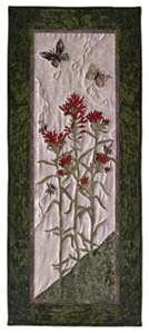 Quilt block of the wildflower Indian Paintbrush, with butterflies.
