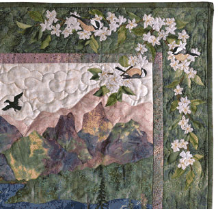 Quilt border with chickadees and cherry blossoms.