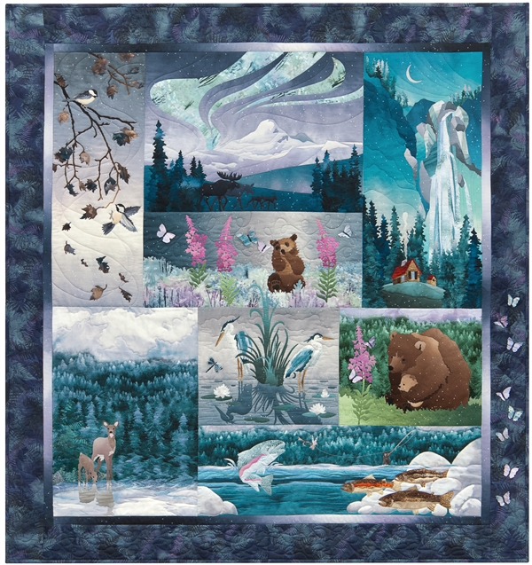 Quilt that shows scenes from the northwoods, with bears, fish, and elk in beautiful jewel tone colors.