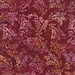 Ornate leaf batik fabric in red, wine purple, and gold.