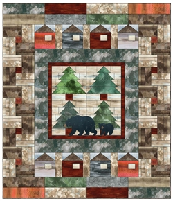 Pieced quilt showing black bears mama and cub walking through stylized campground at night.