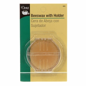 Round of yellow beeswax in slotted plastic case for strengthening thread during sewing, by Collins
