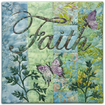 "Quilt block with the word ""Faith,"" stylized butterflies in purple, blue, and green floral patterns."