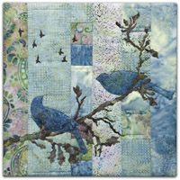 Quilt block with stylized birds on a tree branch and flying in blue and pink floral patterns