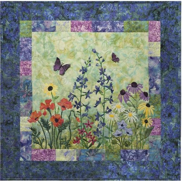 Quilt block showing wildflowers and butterflies.