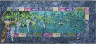 Quilt block showing wisteria blossoms and bees