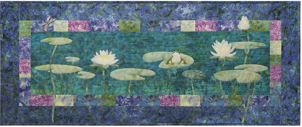 Quilt block showing frog in a pond with lily pads