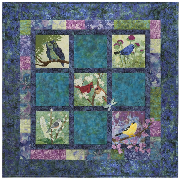 Pieced quilt block with appliqued nocturnal birds