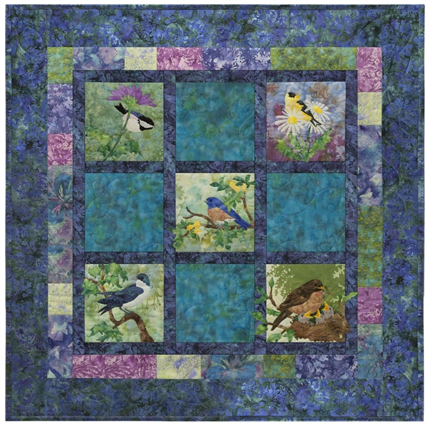 Pieced quilt block with appliqued morning birds.