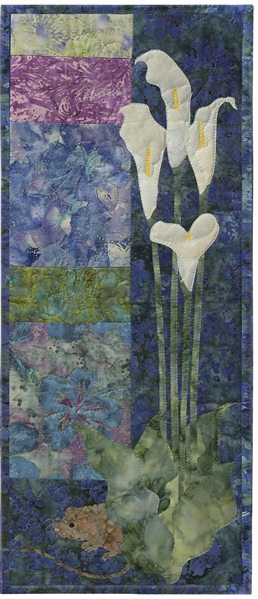 Quilt block showing a mouse hiding behind white lilies.