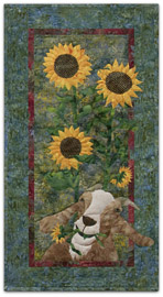 Quilt block of a goat eating sunflowers.