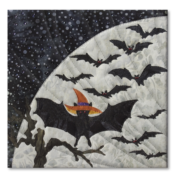 Quilt block of a bat showing off its costume before catching up with the other bats, in front of a large moon
