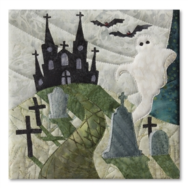 Quilt block of a ghost rising from behind a tombstone in a graveyard, with a spooky haunted house in the background, beneath a huge moon
