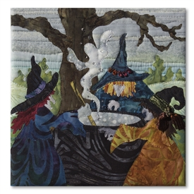 Quilt block of three witches around a cauldron, raising spirits and discussing Eat, Pray, Love