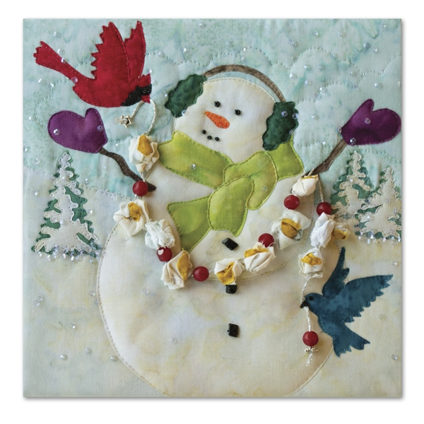 Quilt block of a snowman celebrating snowfall with two bird friends and a popcorn and cranberry garland