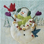 Printed panel of a snowman celebrating snowfall with two bird friends and a popcorn and cranberry garland.