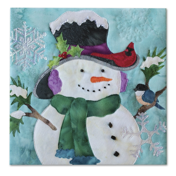 Quilt block of a smiling snowman wearing a hat and scarf, while a cardinal and a blue bird perch on him