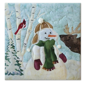 Quilt block of a snowman making friends with an elk calf
