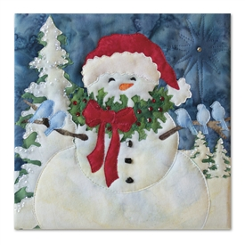 Quilt block of a snowman caroling with armfuls of blue birds