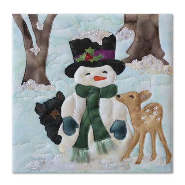 Quilt block of a bear cub and a fawn cuddling with a snowman during the chilly first frost