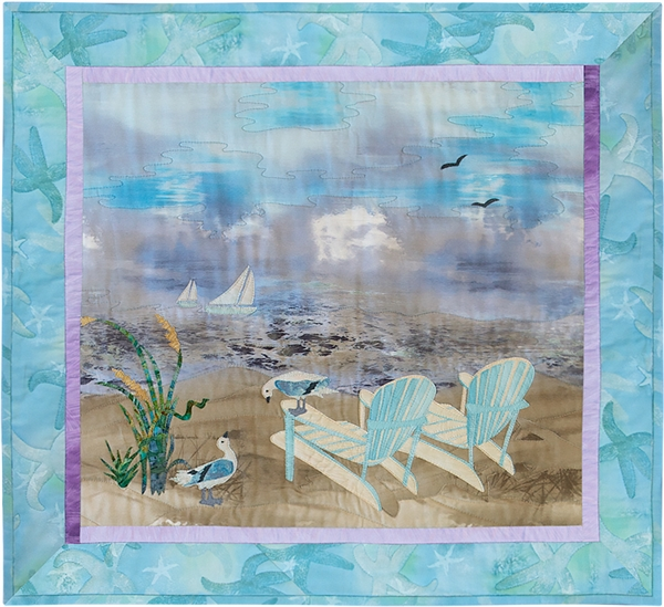 Quilt block of two Adirondack chairs on the beach, looking out at sailboats on the ocean.
