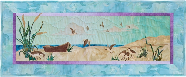 Quilt block of an empty boat on the beach, with sandpipers circling and looking for food.