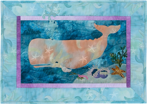 Quilt block of a frolicking sperm whale and group anemones, a starfish, and a little crab.
