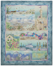 Quilt that shows playful beach and ocean scenes in soft, summer colors.